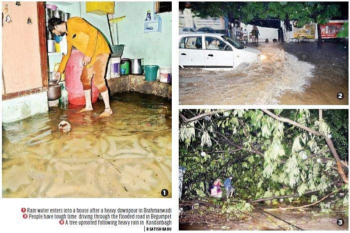 Three dead as heavy rain halts life in Hyderabad""