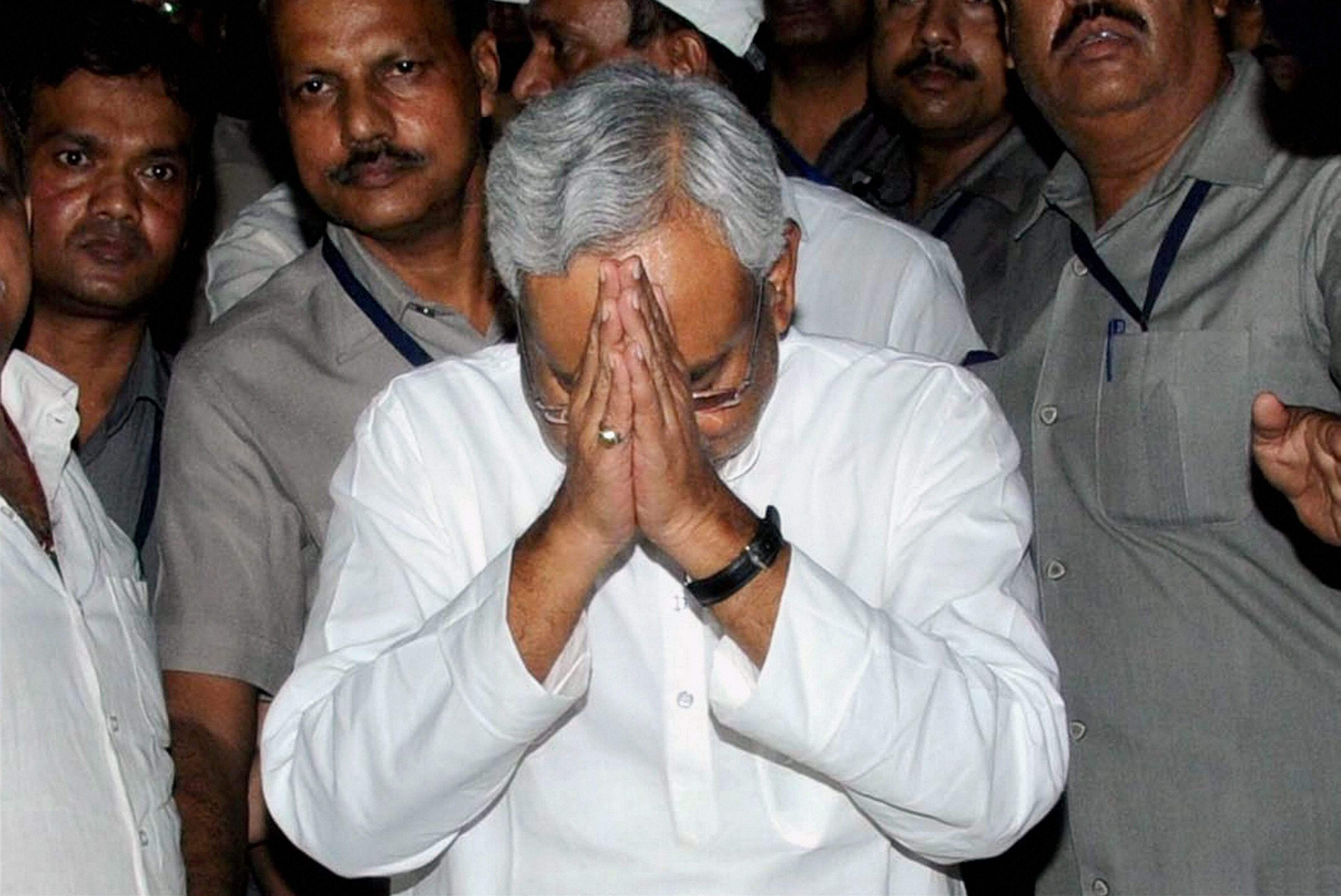 Nitish Kumar gestures before the media after he resigned as Bihar Chief Minister in Patna on Wednesday. (PTI)