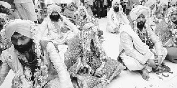 18 couples marry at Sikh mass wedding- The New Indian Express