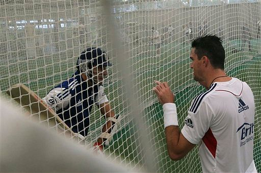 England cricket player Kevin Pietersen, right, coaches Steven Finn during a batting practice in Sydney, Australia, Tuesday, Nov