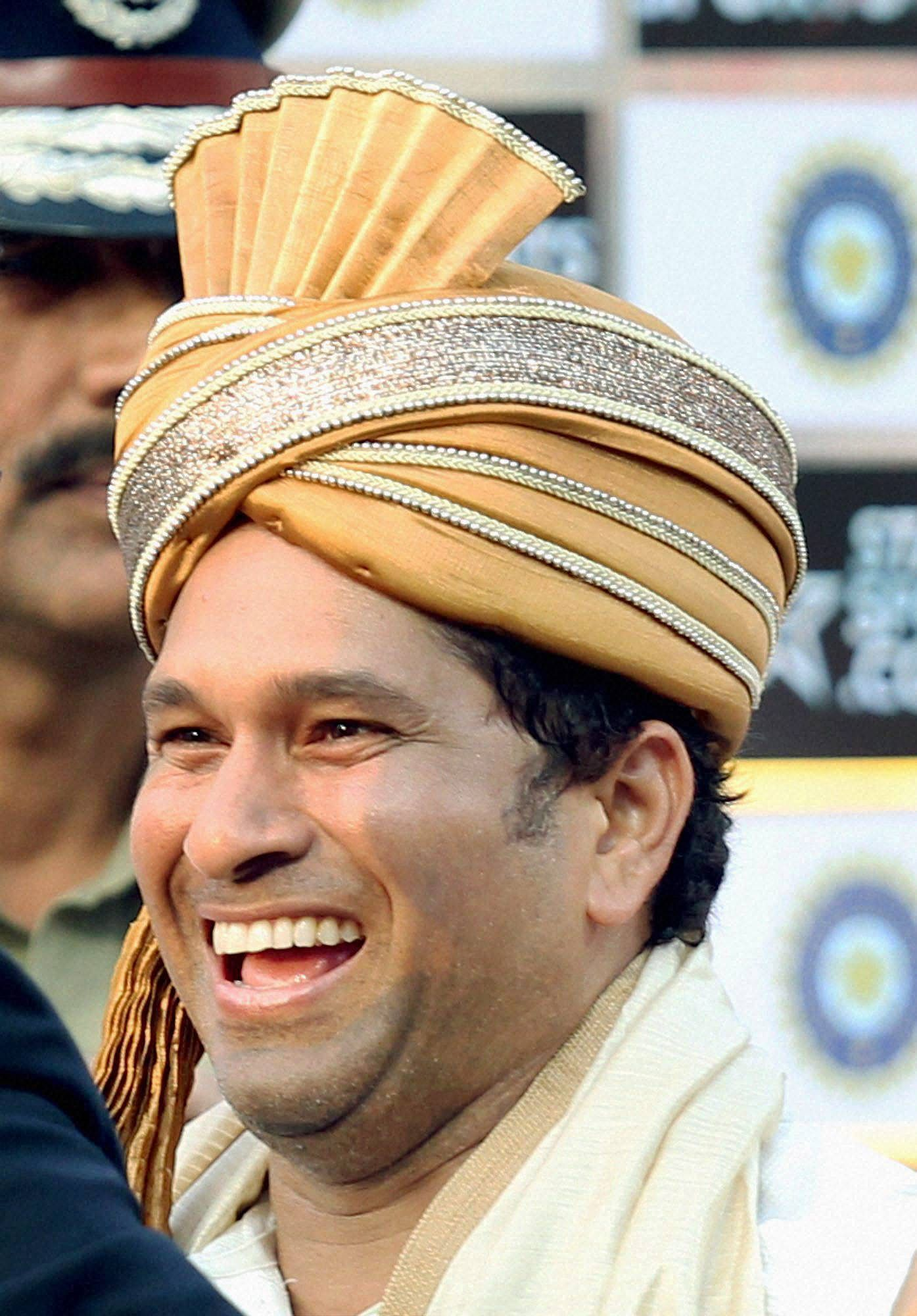 Caption Kolkata Master blaster Sachin Tendulkar is honoured at the presentation ceremony after the end of the first Test match against West Indies at Eden Garden in Kolkata on Friday