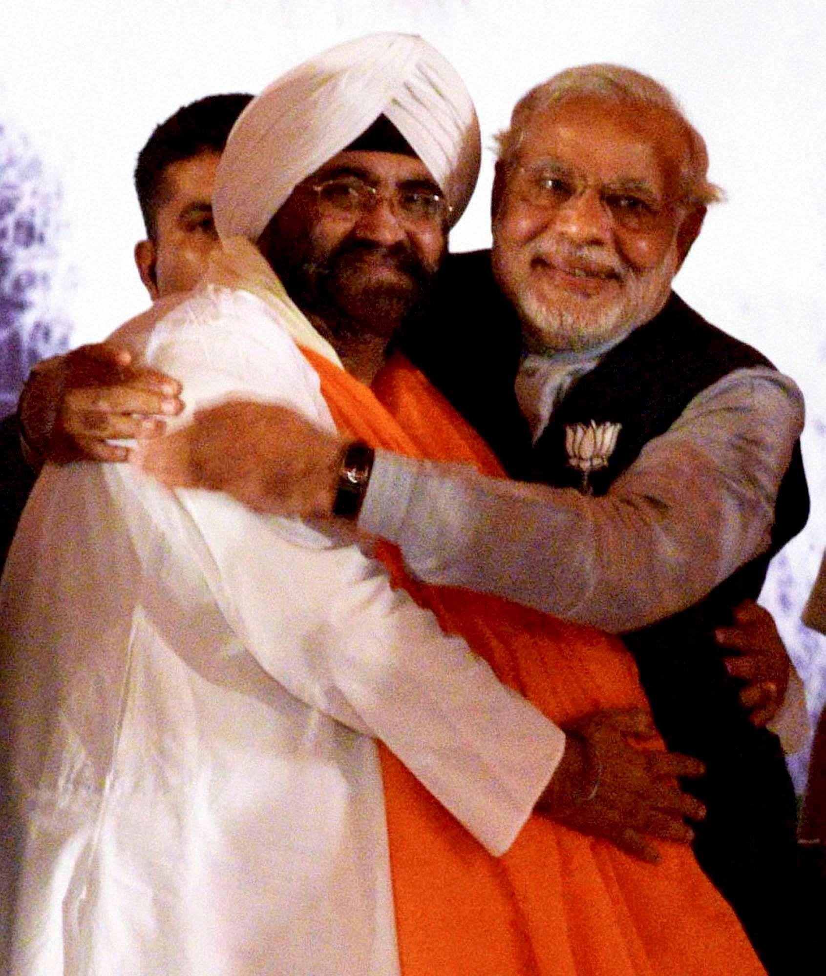 Modi_ManmohanCousin_PTI