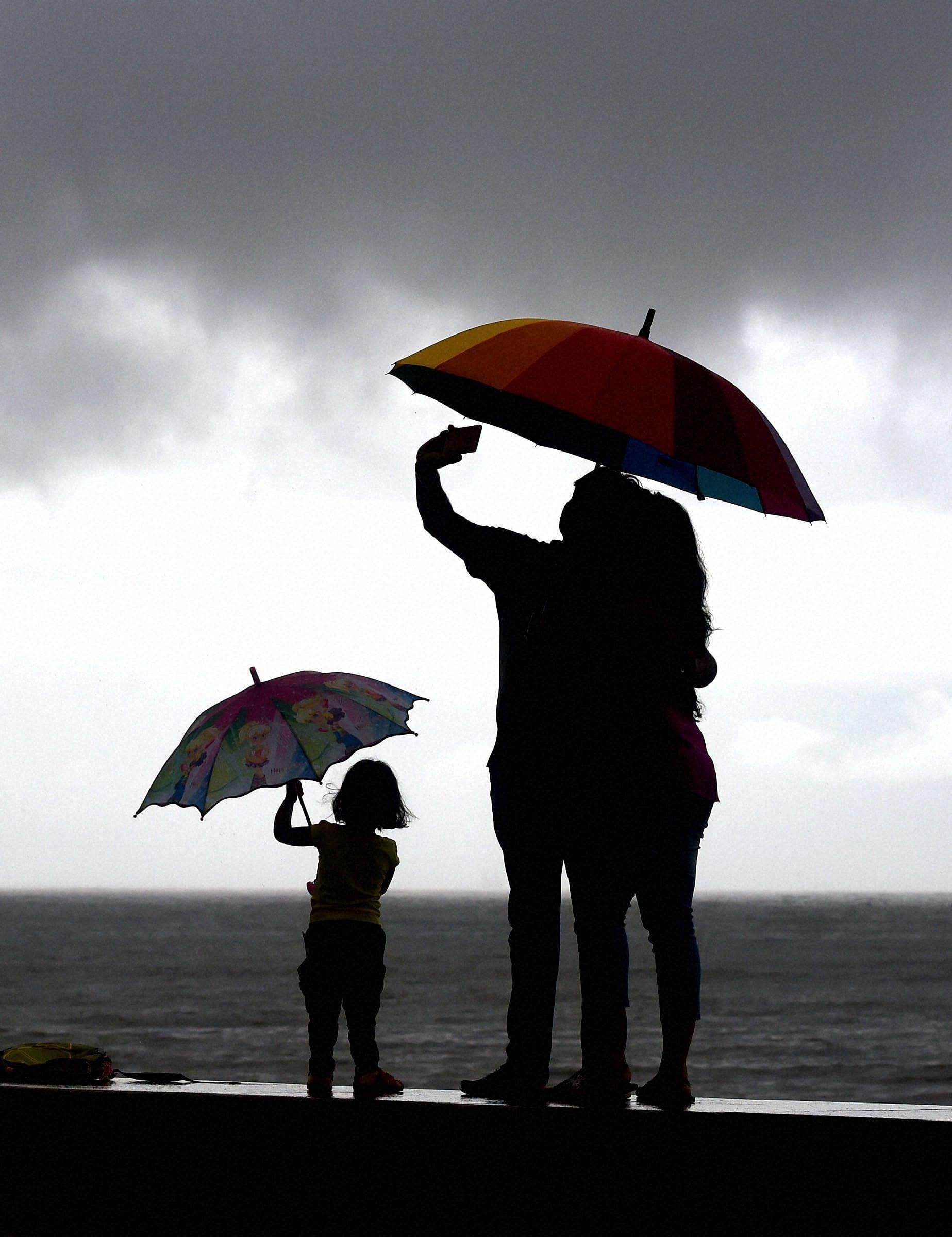 family-monsoon-mumbai-PTI
