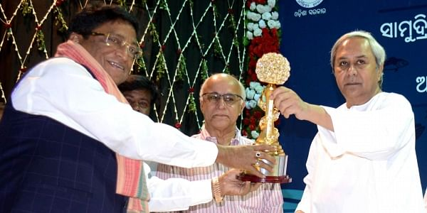 CM Naveen Patnaik felicitates chairman of Falcon Group Tara Ranjan Patnaik for excellence in export of marine products at the event on Friday. | EPS