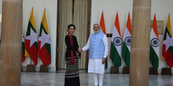 Myanmars State Counsellor Aung San Suu Kyi shakes hands with Prime Minister Narendra Modi before their meeting  at Hyderabad house in New Delhi on Wednesday | (Shekhar Yadav/EPS)