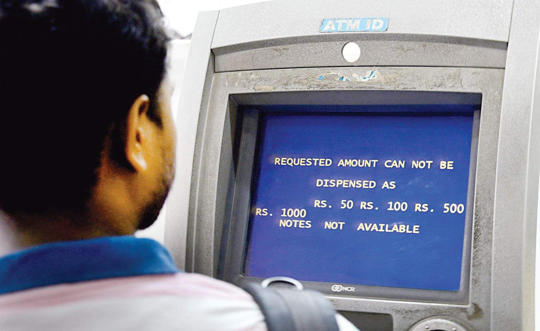 Cash crunch: Long queues at banks, ATMs continue