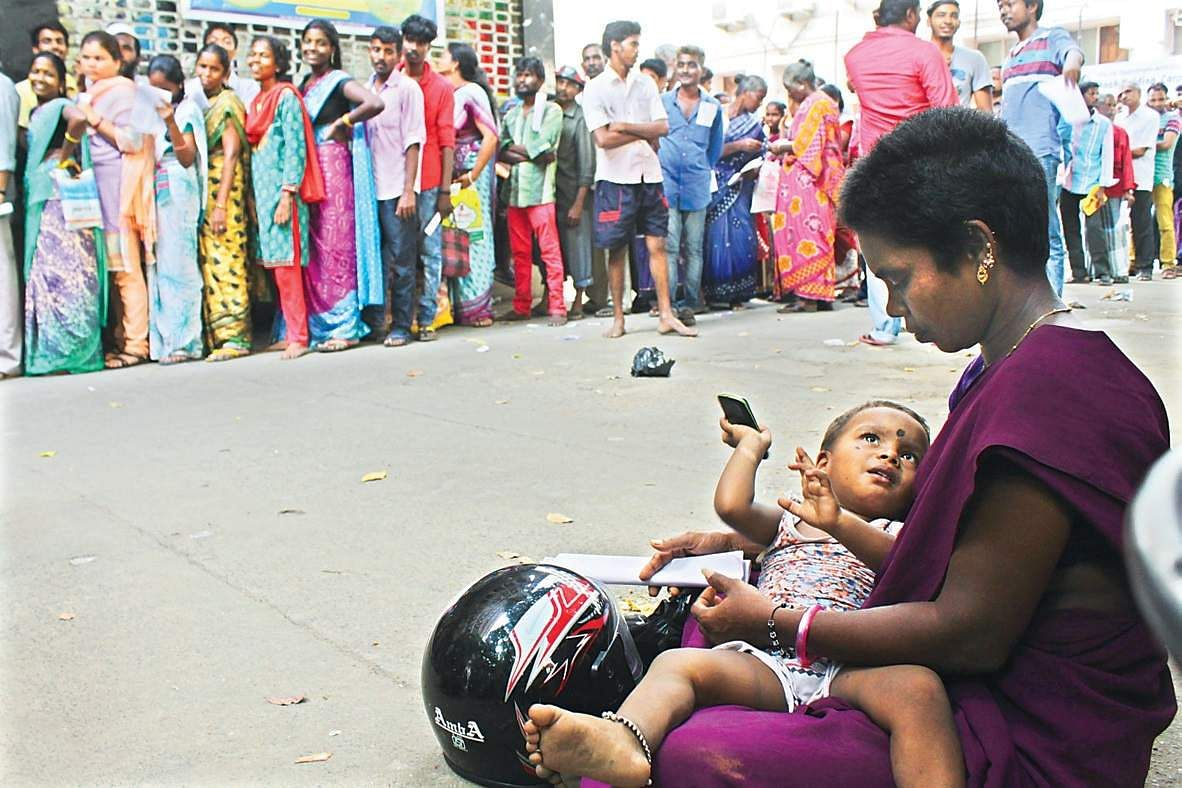 Will agitate against mamata banerjee for attacking our workers bjp the indian express - A Woman Waiting With Her Baby As Her Husband Stands In A Queue At A Bank Near Chennai Harbour On Wednesday Ashwin Prasath