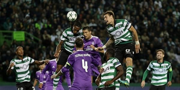 Sporting's and Real's players jump for the ball during the Champions League  Group F soccer match between Sporting CP and Real Madrid at the Alvalade  stadium ...