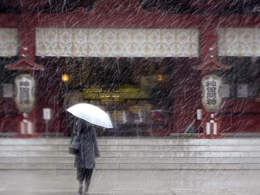 Snow falls in November in Tokyo for first time in 54 years
