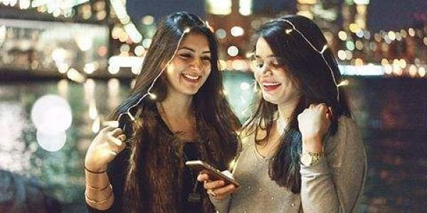 Mumbai-born Purvi Thacker (L) with her Pakistani friend Sarah Munir