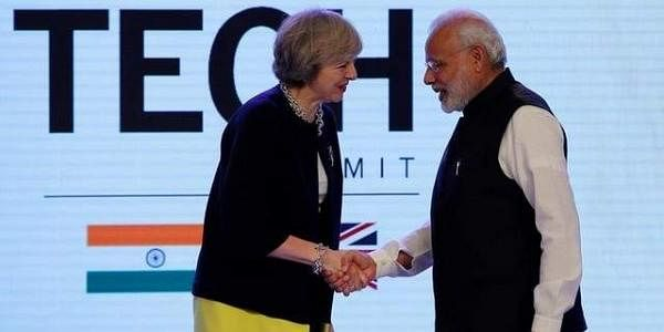 Prime Minister Theresa May shakes hands with Narendra Modi during the India-UK Tech Summit in New Delhi. (Photo | Reuters)