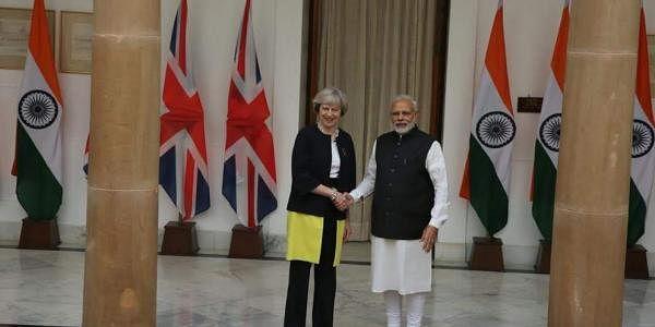 Prime Minister Theresa May shakes hands with Narendra Modi at Hyderabad House in New Delhi. ( EPS |Shekhar Yadav )