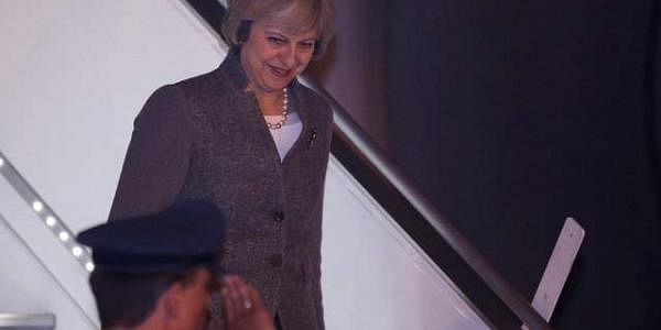 Prime Minister Theresa May disembarks from an aircraft upon her arrival at the airport in New Delhi. (Photo | Reuters)