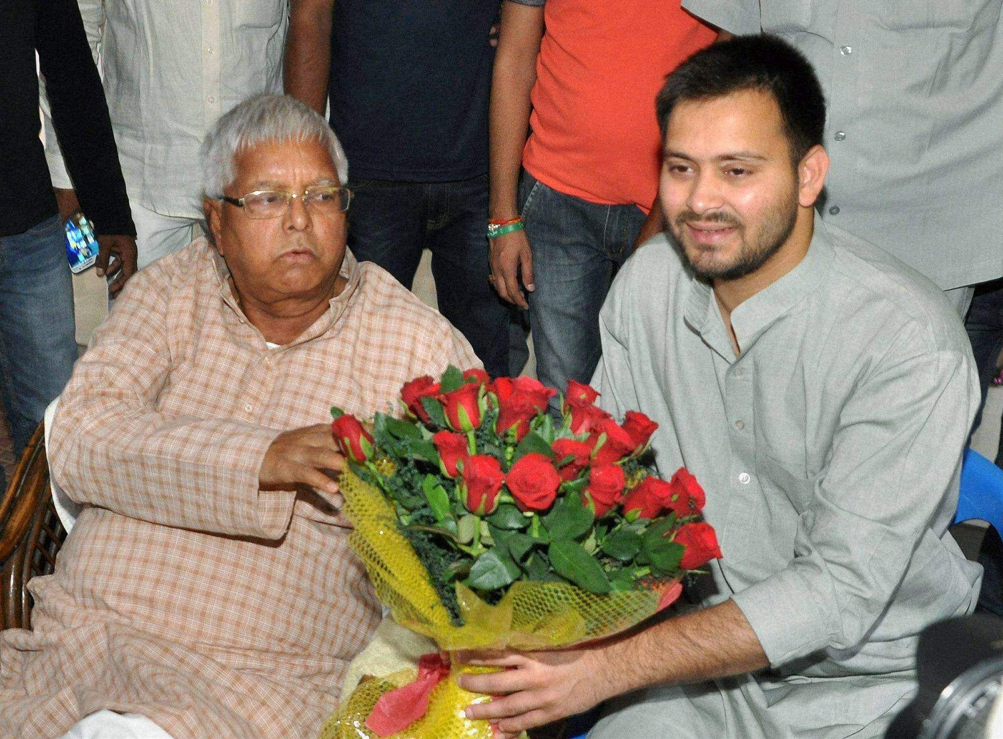 RJD chief Lalu Prasad greeting his son and RJD leader Tejaswi Yadav on his birthday in Patna, Bihar | PTI