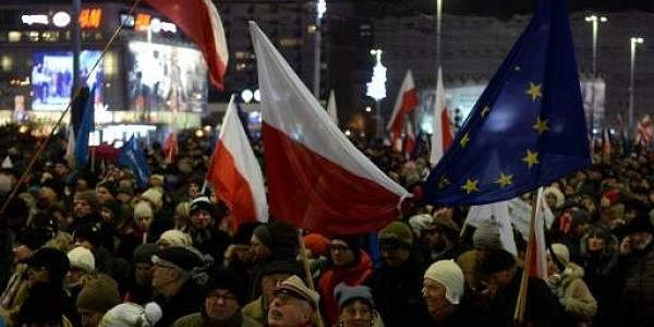Anti-government demonstrators attend a rally in Warsaw on the 35th anniversary of the martial law on December 13. (Photo | AFP)