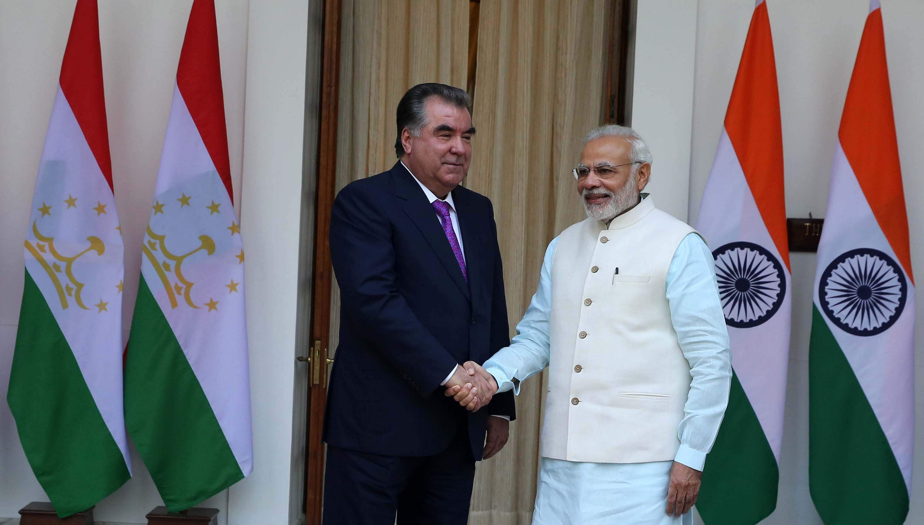 Prime Minister Narendra Modi shakes hand with Tajikistan President Emomalih Rahmon before their meeting in New Delhi on Saturday