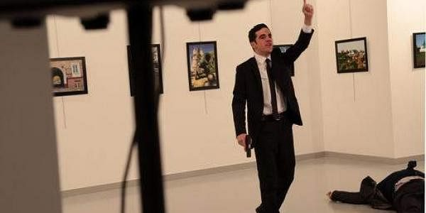 A man gestures near to Andrei Karlov, the Russian Ambassador to Turkey after being fatally shot at a photo gallery in Ankara. (Photo   AP)