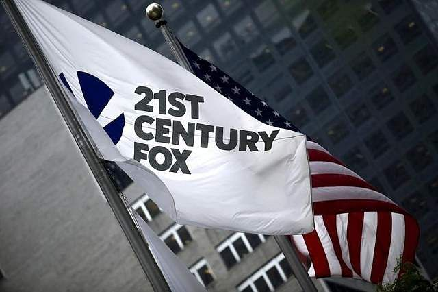 A flag of Twenty-First Century Fox Inc is seen waving at the company headquarters in New York. (File photo | Reuters)
