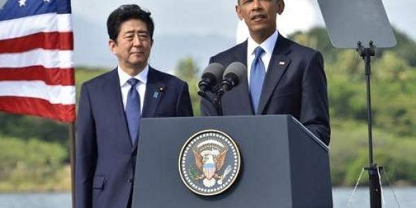 Barack Obama (C) speaks as Shinzo Abe listens at Kilo Pier overlooking the USS Arizona Memorial on December 27 at Pearl Harbor. (Photo | AFP)
