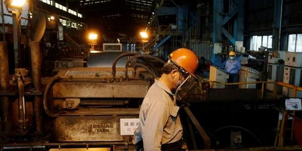 A worker walks inside the China Steel Corporation factory, in Kaohsiung, southern Taiwan August 26. (File Photo | Reuters)