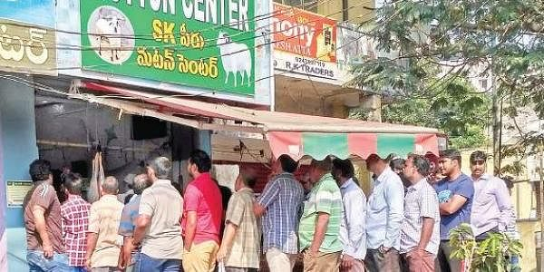 People stand in long queues in front of a mutton shop near Seethampeta in Visakhapatnam on Sunday | Express