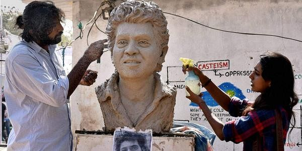 Student artistes making a clay model of the research scholar Rohith Vemula at Hyderabad University in Hyderabad. (File Photo | PTI)
