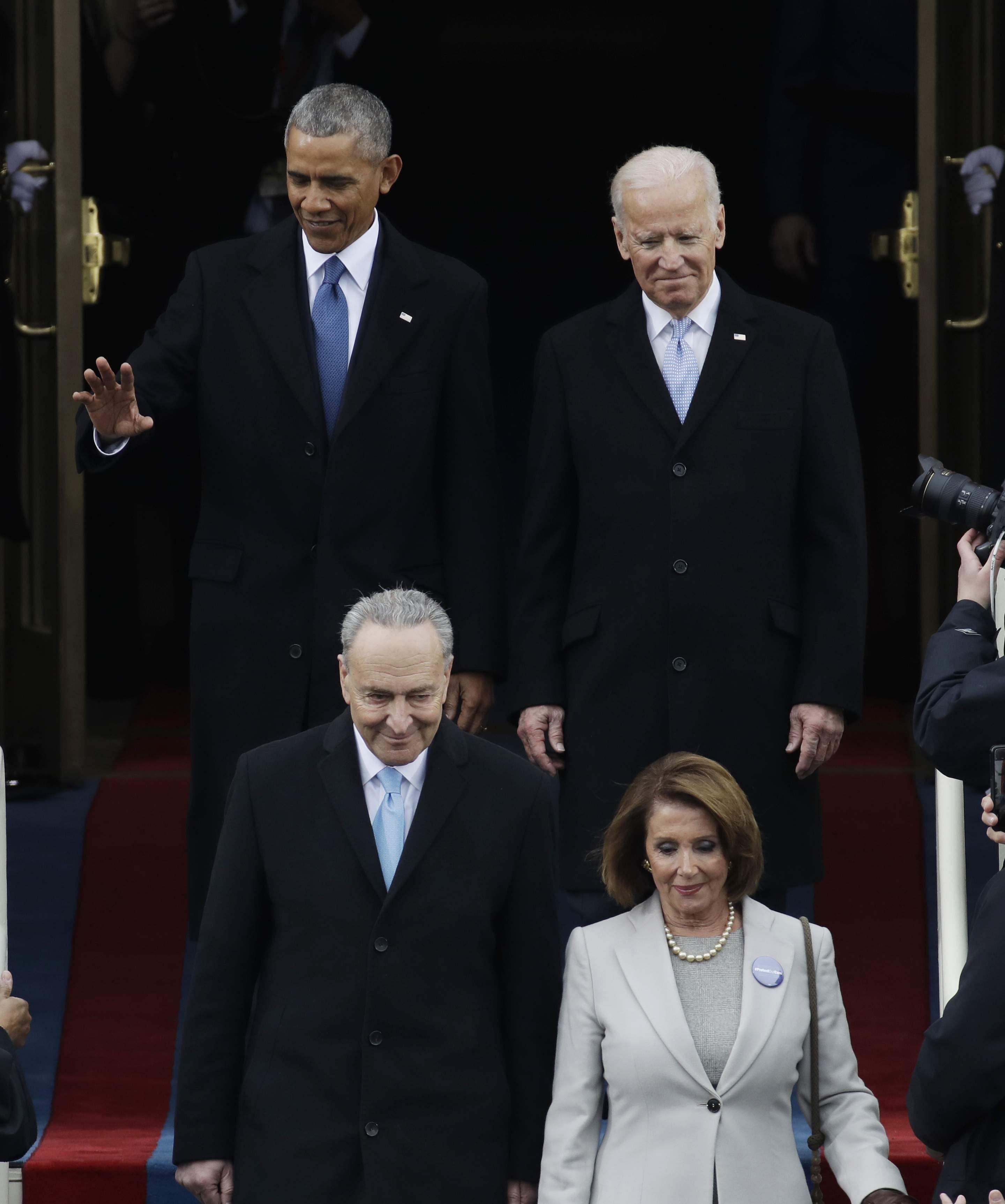 President Barack Obama, left, arrives with Vice President Joe Biden before the 58th Presidential Inauguration