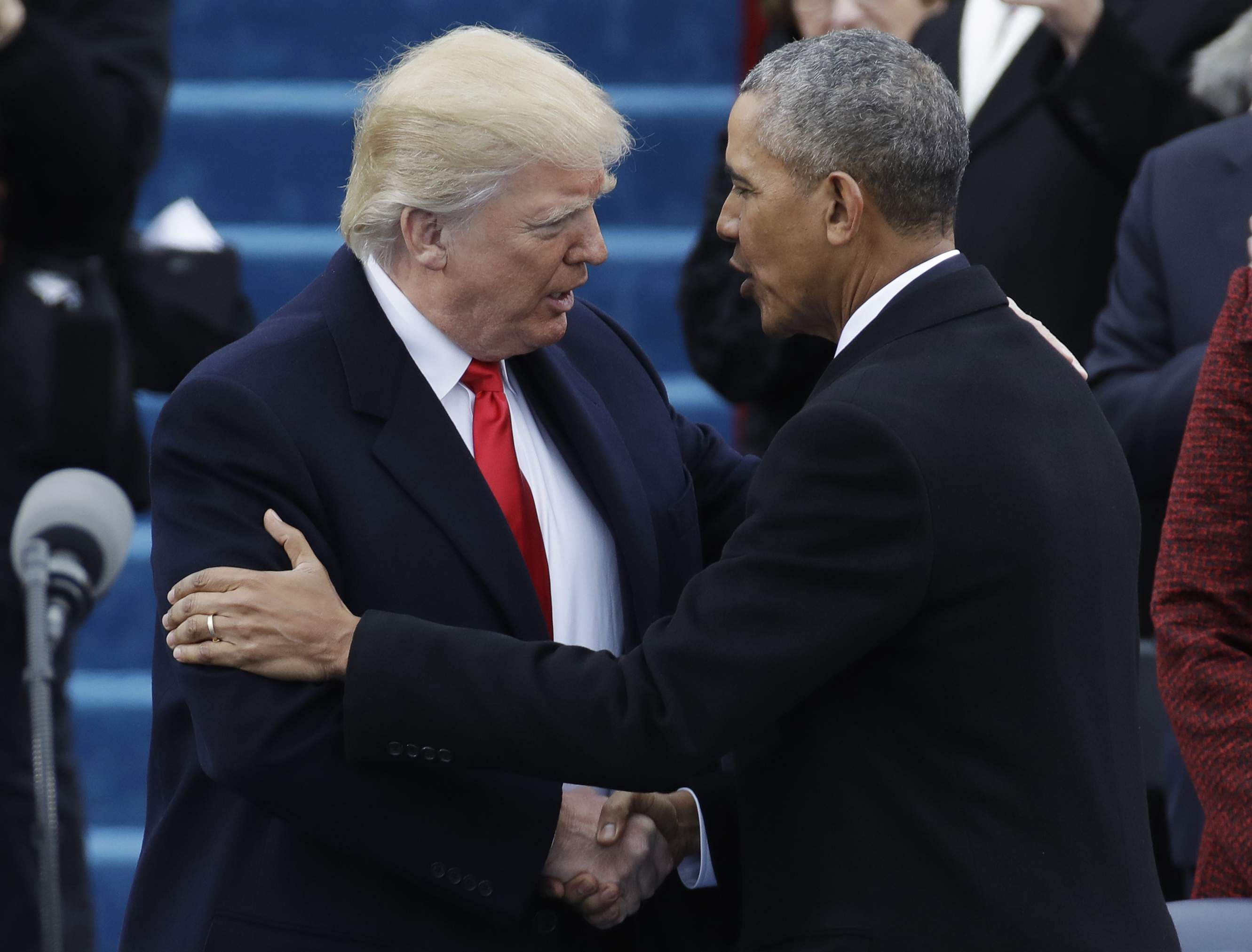 President-elect Donald Trump, left, shakes hands with President Barack Obama before the 58th Presidential Inauguration
