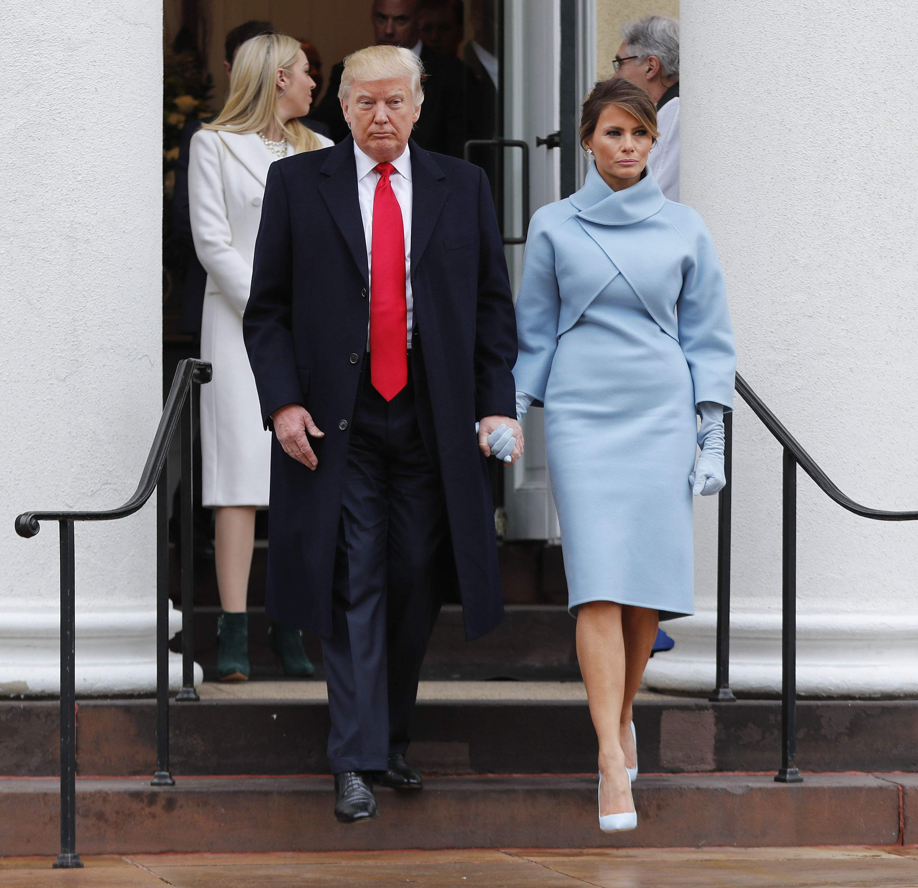 President-elect Donald Trump and his wife Melania walk out together after attending church service at St. John's Episcopal Church across from the White House in Washington