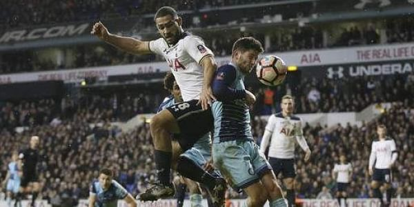 Tottenham's Cameron Carter-Vickers, left, competes for the ball with Wycombe Wanderers' Joe Jacobson during the English FA Cup fourth round match between Tottenham Hotspur and Wycombe Wanderers at White Hart Lane in London, Saturday Jan. 28, 2017.(Photo |