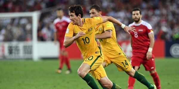 Australia's Robbie Kruse takes on the Syrian defence as Australia defeated Syria in their 2018 World Cup football qualifying match played in Sydney on October 10, 2017. |AFP