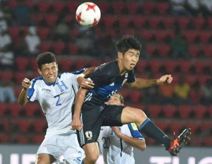Japan (blue) and Honduras (white) players vie for the ball during FIFA U-17 World Cup India 2017 in Guwahati on Sunday. (Photo | PTI)