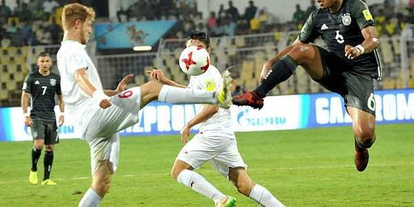 Players of Iran and Germany vie for the ball during their U-17 FIFA World Cup football match.| PTI