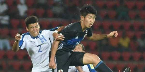 Japan (blue) and Honduras (white) players vie for the ball during FIFA U-17 World Cup India 2017 in Guwahati on Sunday. (Photo   PTI)