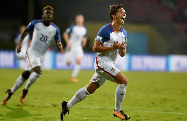 USA player George Acosta celebrates his goal against Colombia. In the first 22 minutes, USA had the better share of ball possession, but they failed to find the equaliser. USA's equaliser came in the 24th minute, courtesy a stunning right-footer by Acosta. | PTI