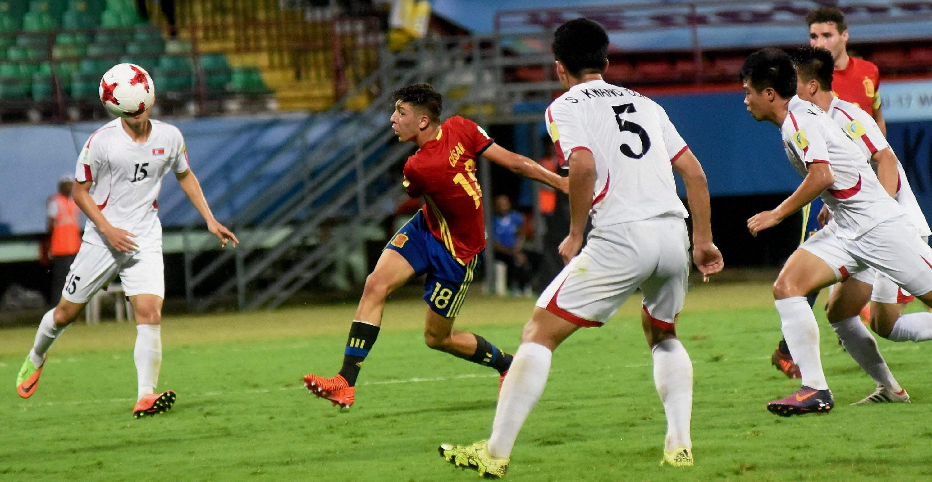 Players of Guinea and Germany white vie for the ball during their U-17 FIFA World Cup football match.|PTI