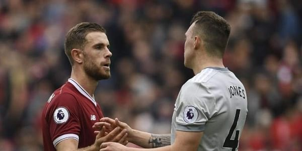 Liverpool's English midfielder Jordan Henderson (L) shakes hands with Manchester United's English defender Phil Jones after the English Premier League football match between Liverpool and Manchester United.|AFP