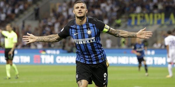 Inter Milan's Mauro Icardi celebrates after scoring during the Serie A soccer match between Inter Milan and Fiorentina at the San Siro stadium in Milan.   AP