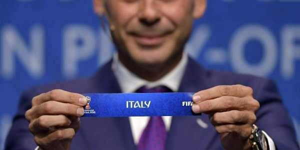 Spanish retired footballer Fernando Hierro shows the name of Italy during the FIFA football World Cup 2018 European play-off draw.|AFP