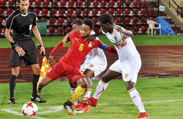 Mali players vie for the ball against Ghana in the quarterfinal match at the Indira Gandhi Athletic Stadium in Guwahati on Saturday.   Photo: PTI