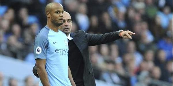 5a39c3f1073 Manchester City manager Guardiola with Manchester City s Vincent Kompany  (Photo