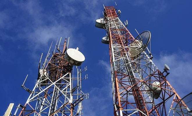 Accuses BJP of scam in spectrum auction recovery