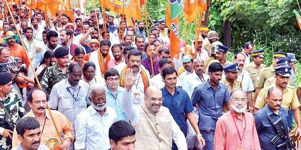 BJP national chief Amit Shah walking with Kummanam Rajasekharan, state party chief, and others from Payyannur to Pilathara on Tuesday. Suresh Gopi, Alphons Kannanthanam, C K Padmanabhan and V Muraleedharan are also seen