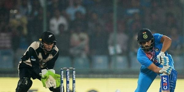 Indian batsman Rohit Sharma plays a shot during the first T20 cricket match between New Zealand and India at Feroz Shah Kotla Cricket Stadium in New Delhi. AFP