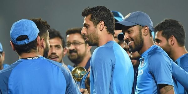 Ashish Nehra being greeted by his teammates for playing his final T20 match in New Delhi. PTI