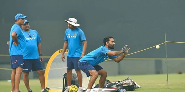 Indian player Dinesh Karthik and coach Ravi Shastri during a practice session ahead of the T20 match against New Zealand in New Delhi.|PTI