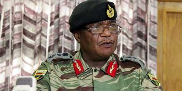 Zimbabwe's Army Commander, Constantino Chiwenga addresses a press conference in Harare.|AP