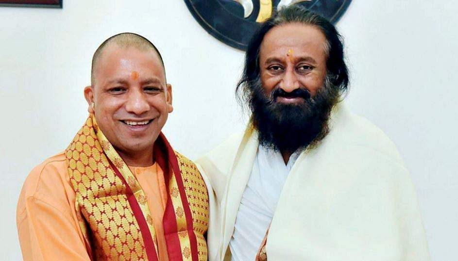 Sri Sri meets Adityanath day before visiting Ayodhya