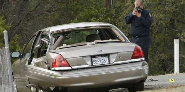 A California Highway patrol officer photographs a vehicle involved in a deadly shooting rampage at the Rancho Tehama Reserve, near Corning, Calif.|AP