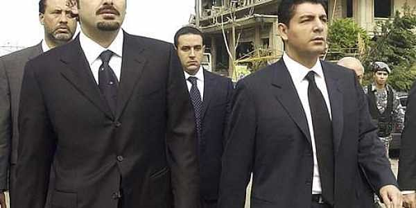 Bahaa Hariri, right, and Saad Hariri, sons of slain Lebanese former Prime Minister Rafik Hariri, visit the scene where their father was assassinated in Beirut.|AP